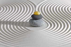pinnacle of zen stones in sand